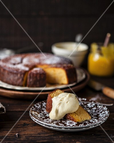 A slice of Clementine cake with citrus cream