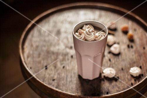 Hot chocolate with spices garnished with meringue