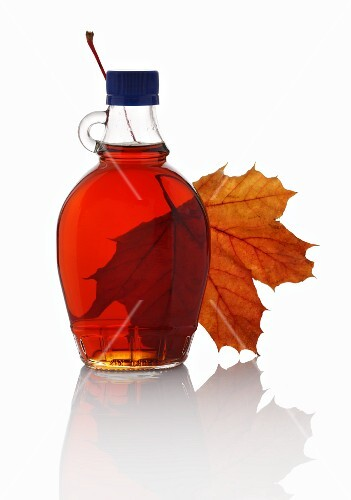 Maple syrup and a maple leaf