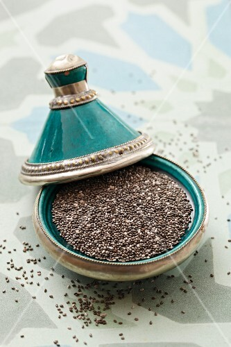Chia seeds in a turquoise dish with silver edges