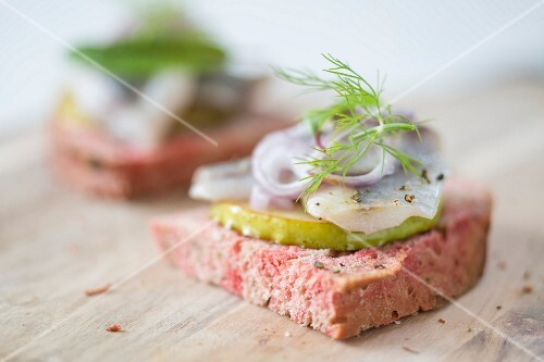 Beetroot bread with soused herring