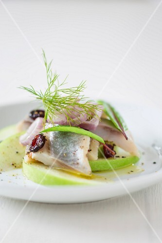 Soused herring with cranberries and apple