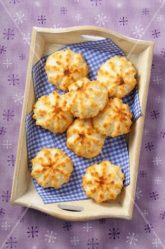 Coconut macaroons on a wooden tray