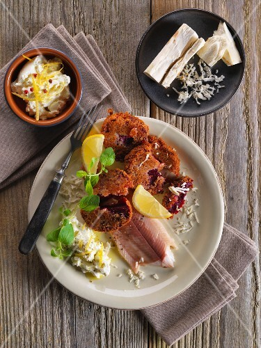 Trout fillets with beetroot cakes and horseradish