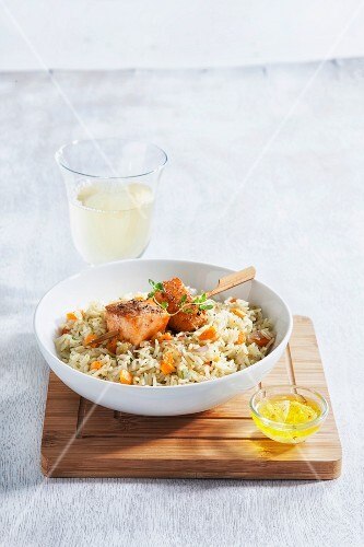 Salmon skewers on spicy rice