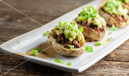 Potatoes filled with minced meat and avocado cream