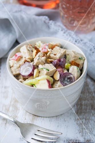 Vegan Waldorf salad with vegetables and almonds