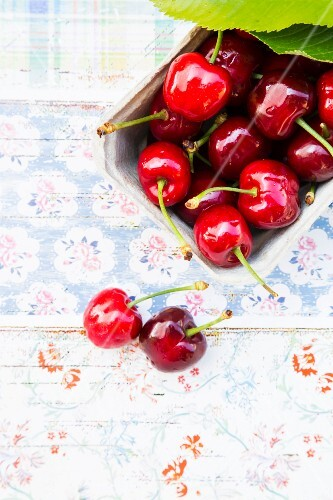Fresh organic cherries in a paper punnet (seen from above)