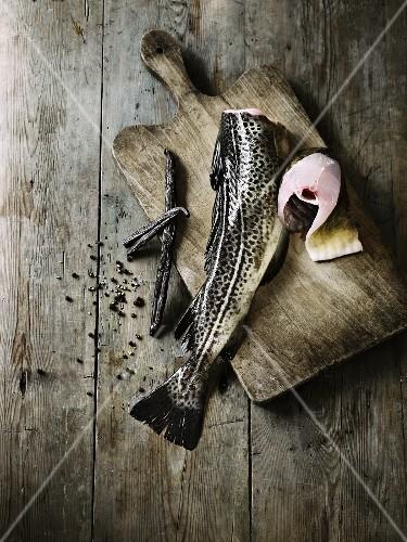 An arrangement featuring trout, vanilla pods and pepper