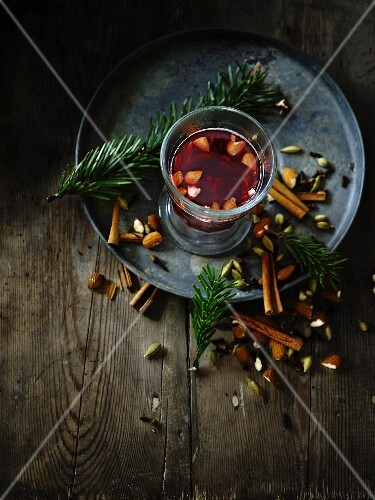 Hot red wine punch with almonds and spices