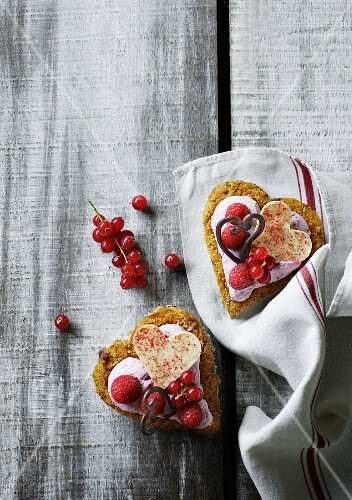 Mini heart-shaped cakes topped with berries for Valentine's Day