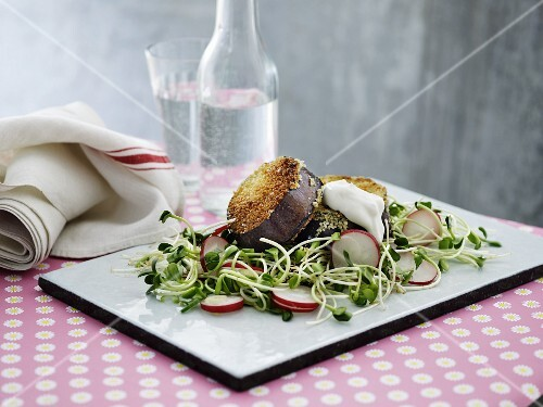 Aubergine escalope on a bed of salad