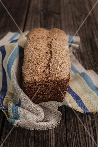 Homemade wholegrain rye bread on a rustic wooden table