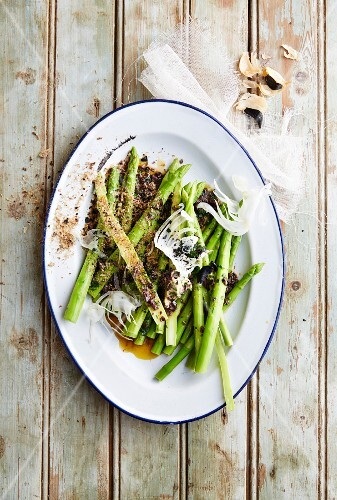 Asparagus salad with biltong, black garlic, fennel and olive butter (South Africa)