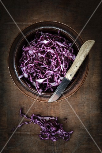 A bowl of freshly grated red cabbage (seen from above)