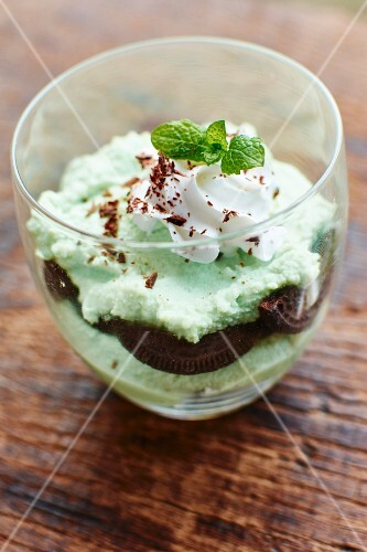 A vegan layered dessert with mint parfait made from tofu and chocolate biscuits