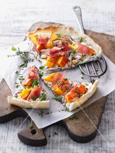 Pumpkin and herb tart flambée with ham