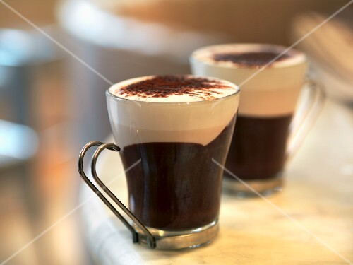 Bicerin (a hot drink made from espresso, cocoa and whole milk) into glass cups