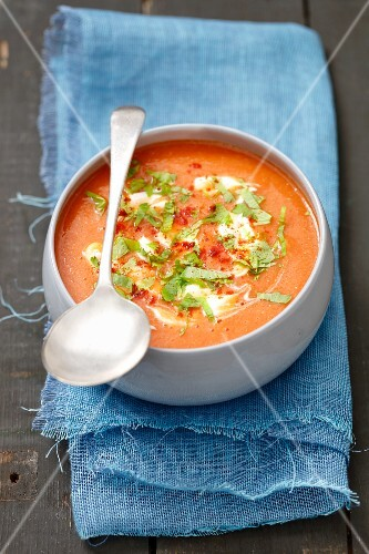 Cream of tomato and lentil soup with celery leaves