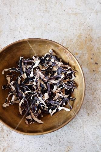 Dried wood ear mushrooms in a metal bowl