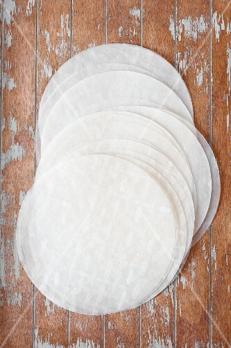 Round sheets of rice paper on a wooden surface