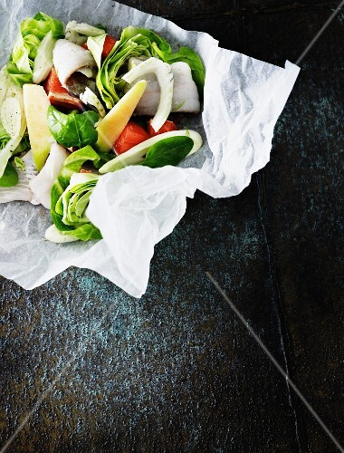 Fish and vegetables in parchment paper