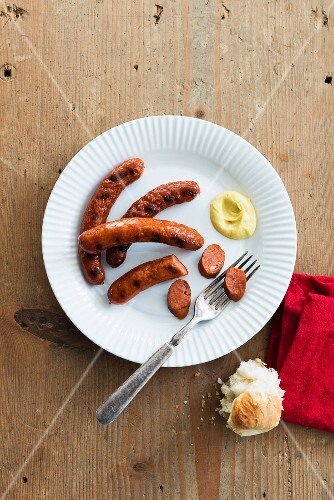 Grilled Merguez sausages with mustard and a roll
