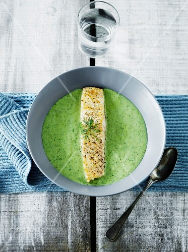 Cold avocado soup with fish steak