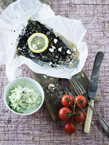 Fish fillets with a herb crust in parchment paper
