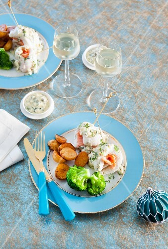 Fish rolls with smoked salmon and a caper and dill sauce for Christmas