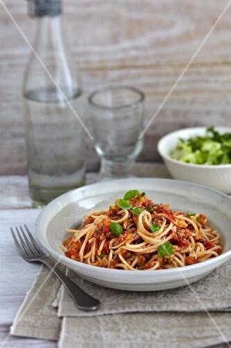 Spaghetti bolognese with basil