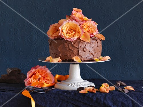 A chocolate ganache cake decorated with roses
