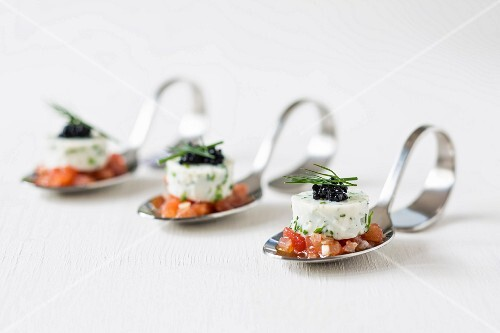 Soya yoghurt terrine on diced tomatoes on canapé spoons