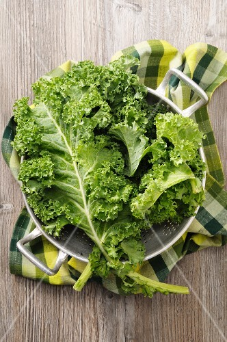 Fresh kale in a colander (seen from above)
