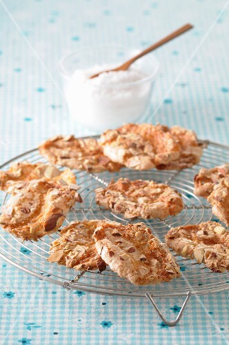 Crispy almond biscuits on a cooling rack