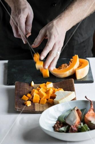 Pumpkin being diced