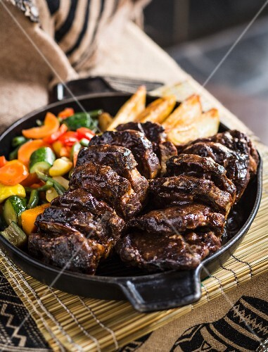 Roasted collar of lamb with potatoes and vegetables