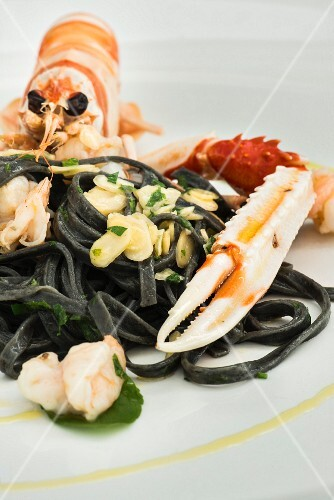 Squid pasta and a langoustine with almonds, Restaurant Bacino Grande in Porto Cesareo, Italy