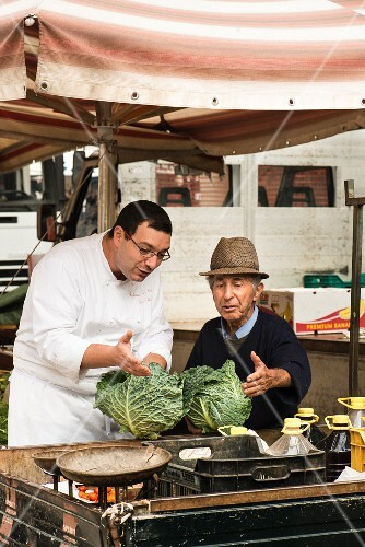 Chef Stefano Nuzzo buying fresh vegetables at the market in Poggiandro, Italy