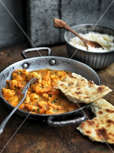Indian prawn curry with unleavened bread and rice
