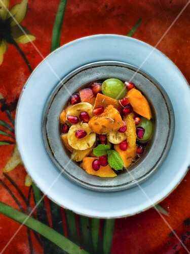 Indian fruit salad with pomegranate seeds