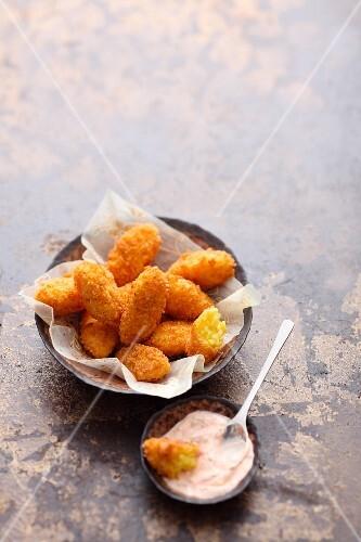 Oriental saffron rice croquettes with a yoghurt dip