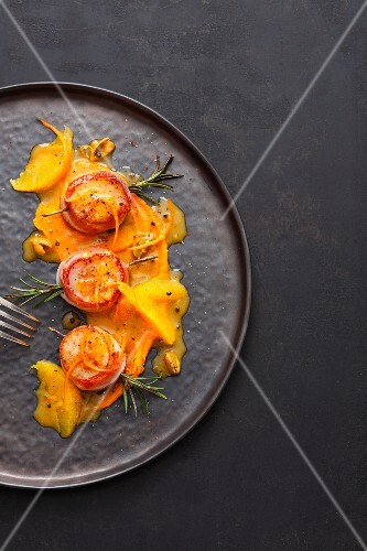 Scallops on pumpkin cream with orange and cardamom butter