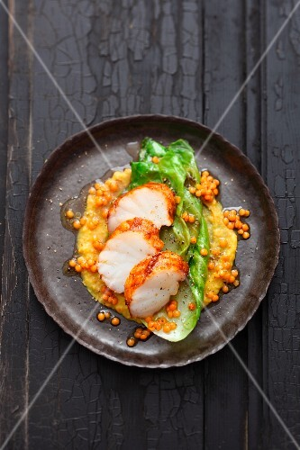 Monk fish tandoori with lentils and pointed cabbage