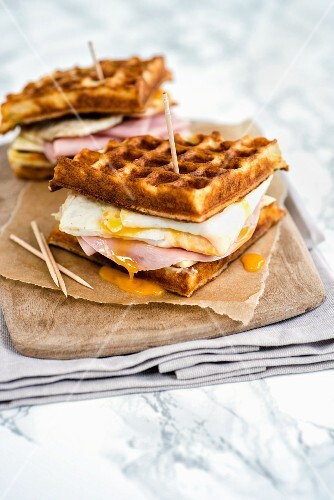 Parmesan waffles with ham, cheese and fried egg