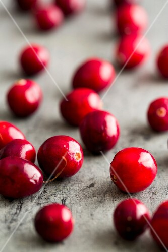 Cranberries on a wooden surface