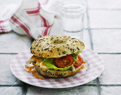 A chicken and tomato bagel