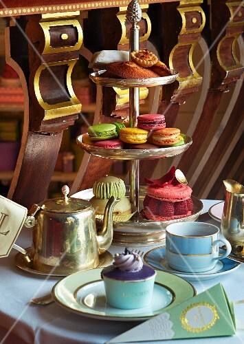 Cupcakes and macaroons on a cake stand for teatime in a restaurant