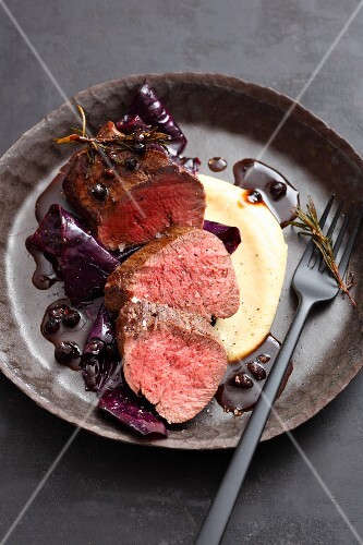 Saddle of venison with red cabbage and juniper berries