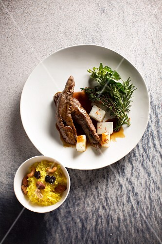 Lamb fillets on a clove and carob sauce with saffron rice and kohlrabi (Syria)
